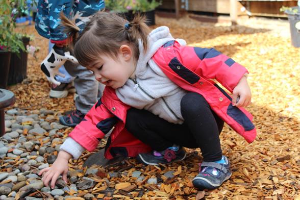 Toddler reaching for rock
