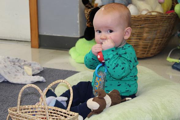 Baby boy holding toy