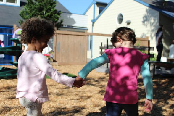 Preschool children holding hands