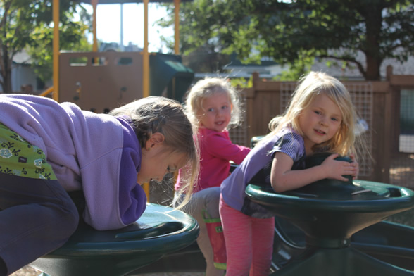 Preschool children on play structure