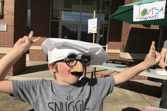 Child in costume at pancake party