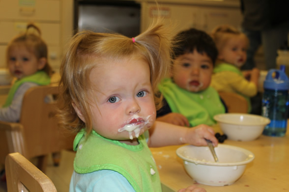 Young child eating yogurt