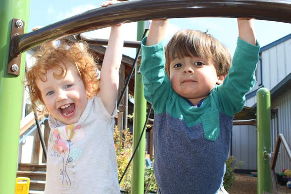 Smiling toddlers playing
